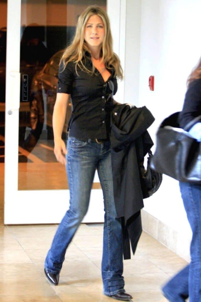 Jennifer Aniston wearing bootcut jeans.