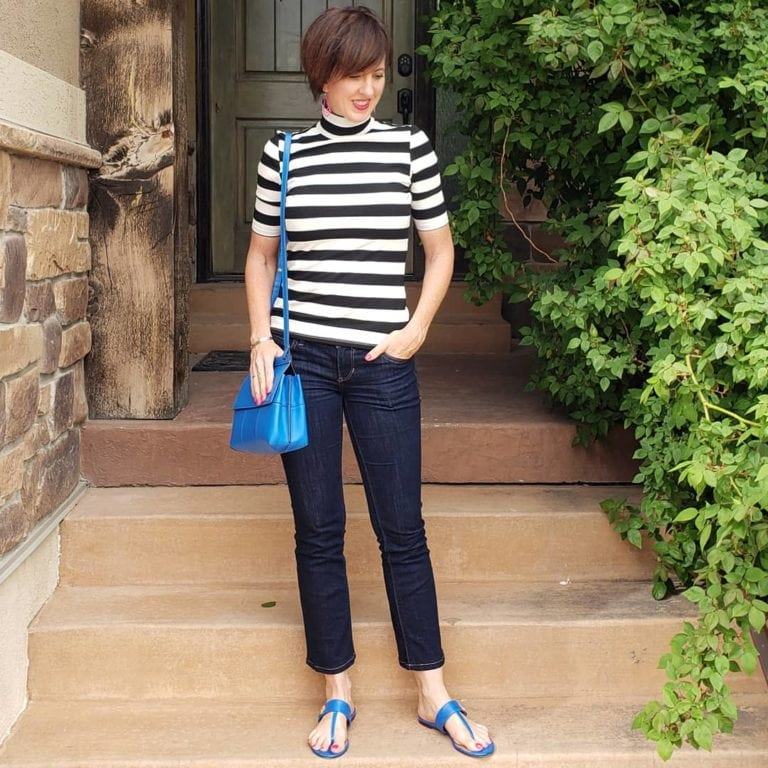 Black and white stripe turtleneck and blue purse