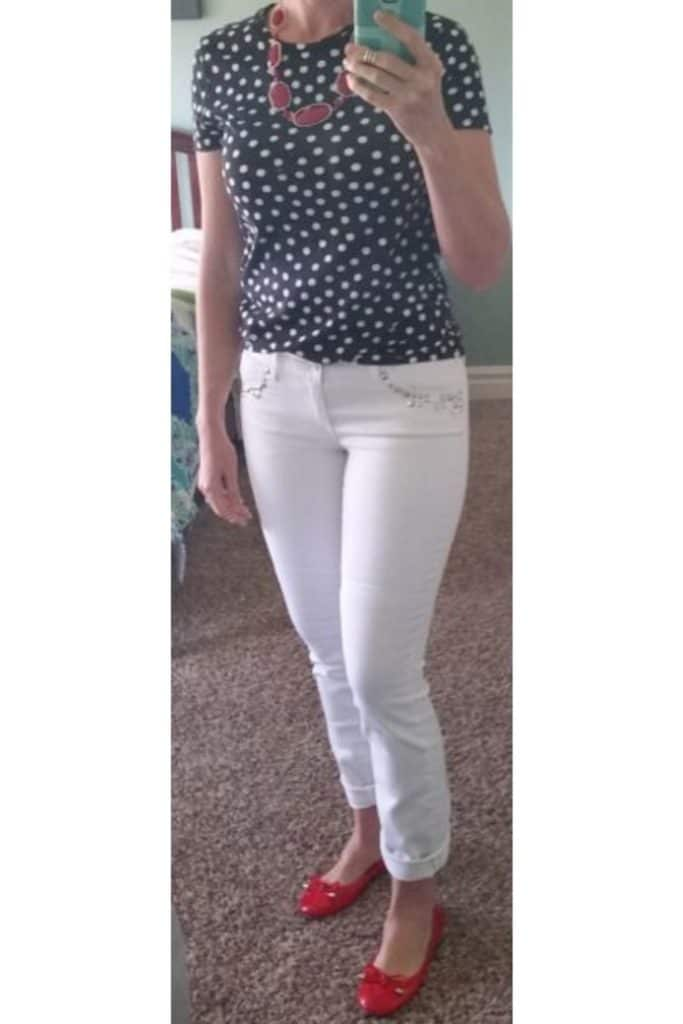 Pattern top with white pants.