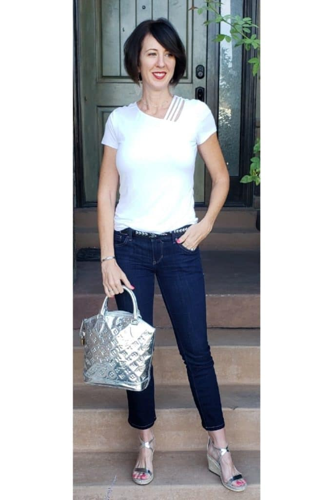 April from Stunning Style showing you how to find your style wearing a white top with cropped jeans and silver accessories.