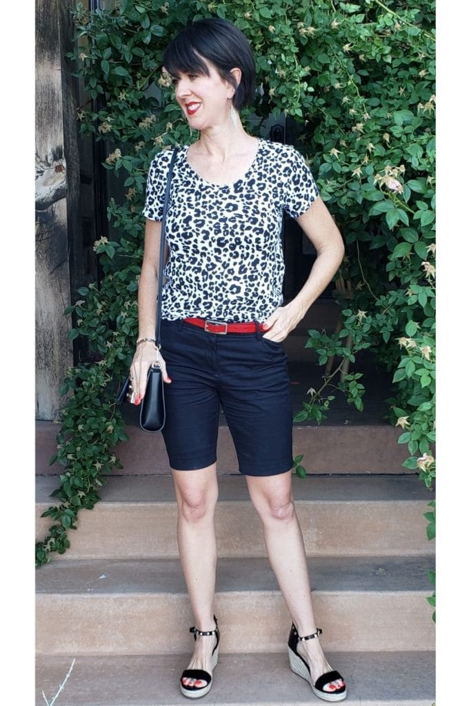 April from Stunning Style showing you how to find your style wearing a leopard pattern top and navy Bermuda shorts.