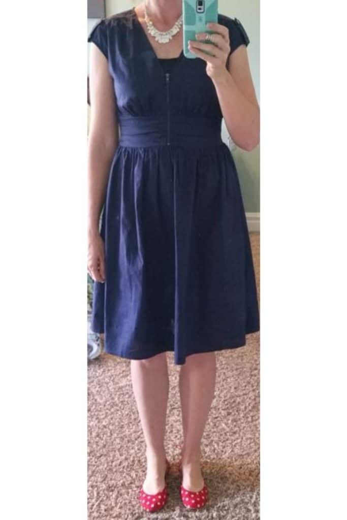 Blue dress with red shoes.