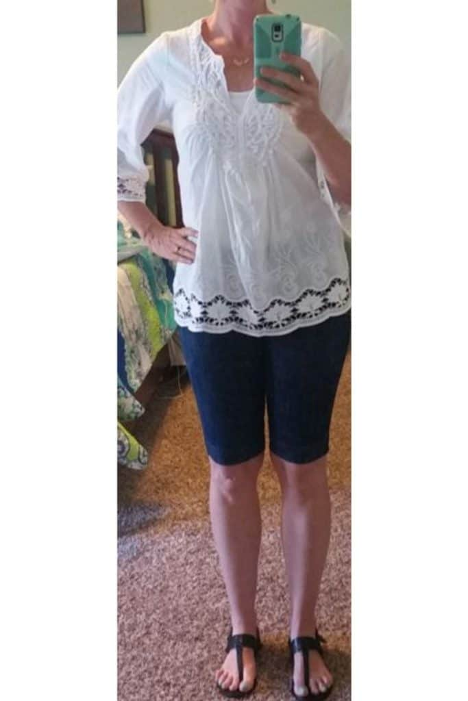 White top with navy Bermuda shorts.