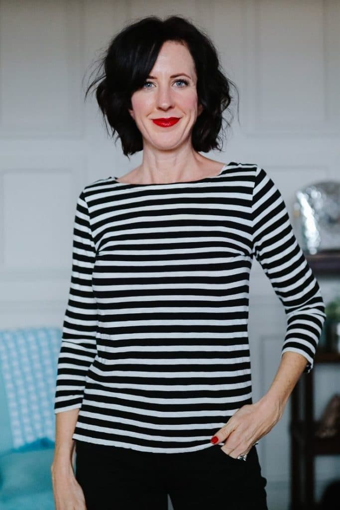April from Stunning Style wearing a black and white striped top.