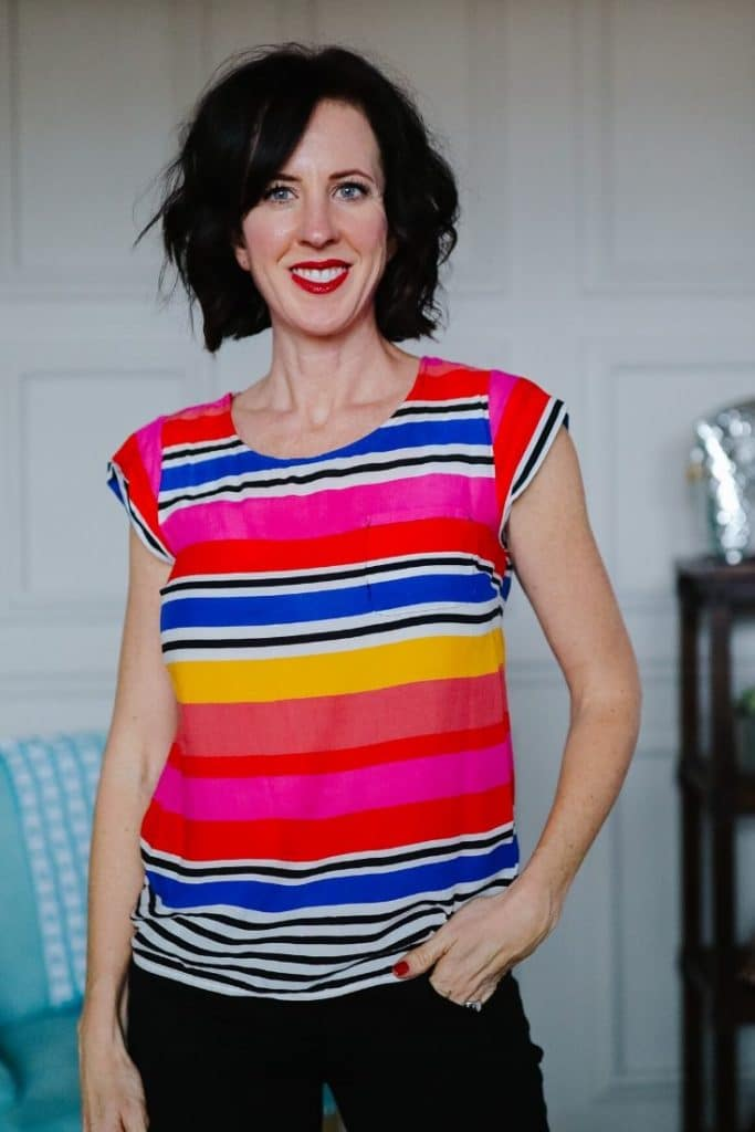 April from Stunning Style wearing a bright colored striped top.
