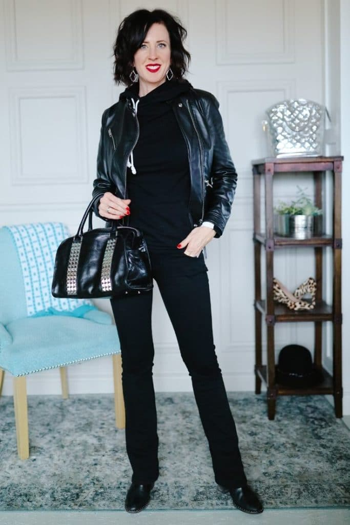 April from Stunning Style wearing a black leather jacket with black pants and a black leather bag.