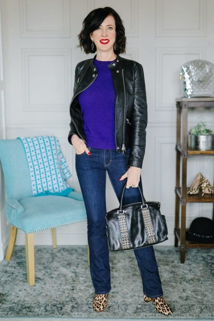 April from Stunning Style wearing a black leather jacket with a purple top.