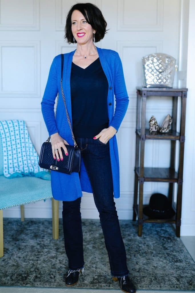 April from Stunning Style wearing a long blue cardigan with black pants.
