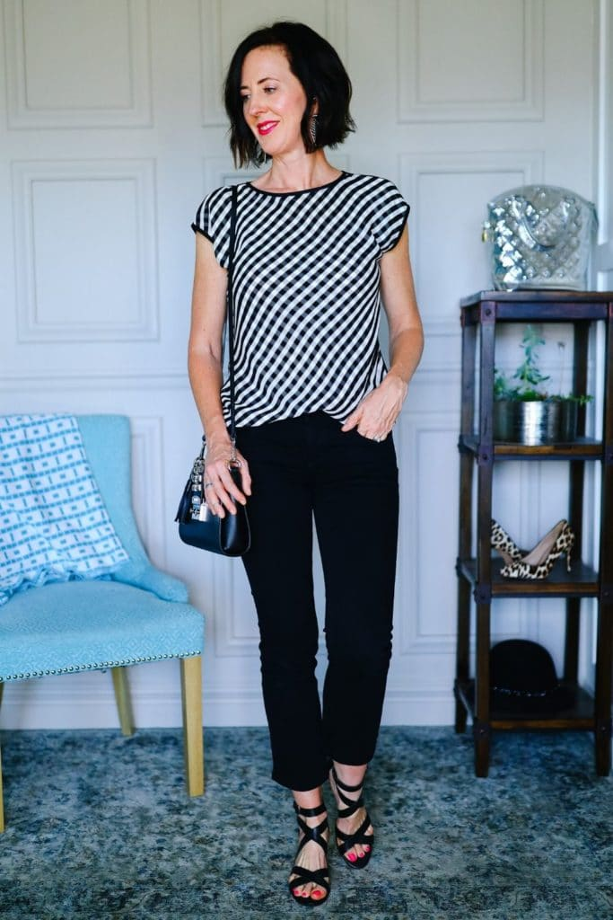 What Does Your Style Say About You? - Black and white top and black pants and sandals