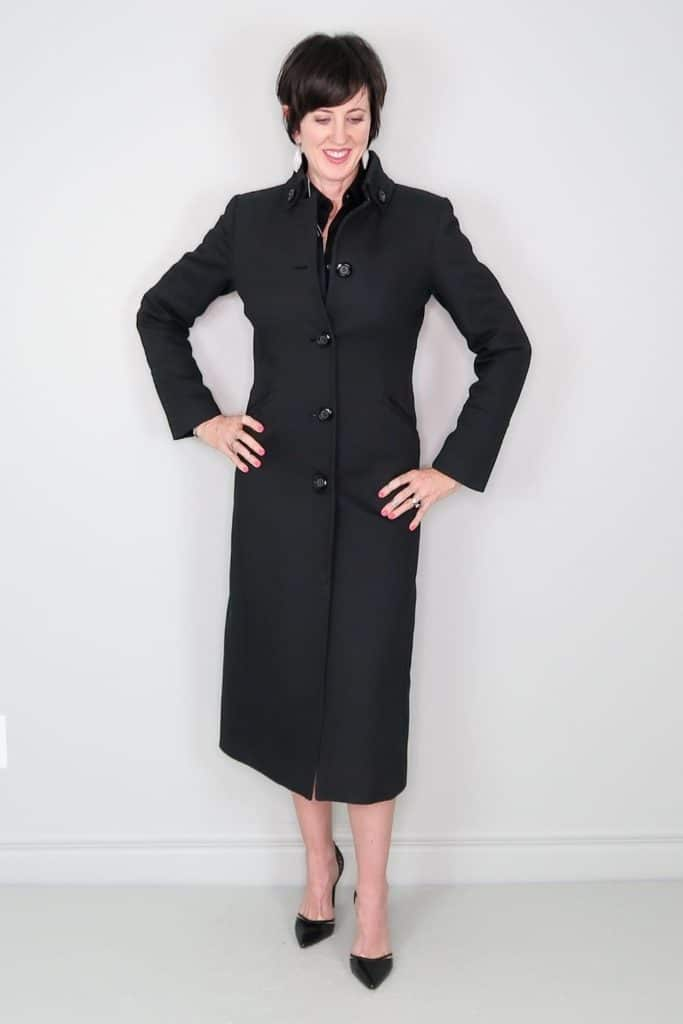 April from Stunning Style showing off her affordable wardrobe by wearing a long black wool coat.