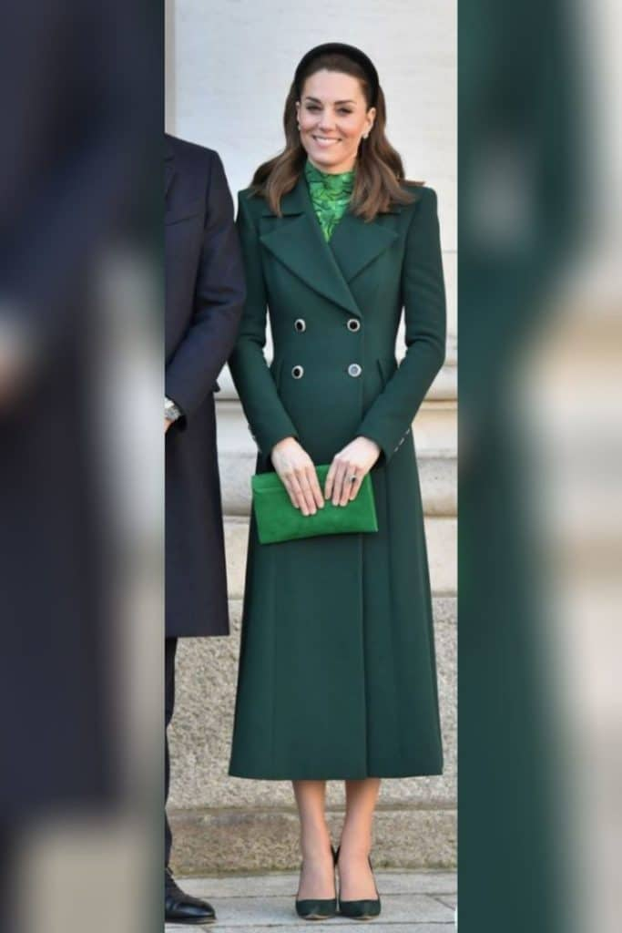 Kate Middleton wearing a long green blazer coat.