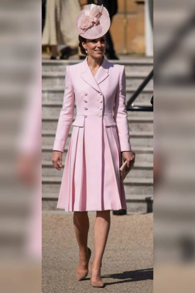 Kate Middleton wearing a pink blazer coat dress.