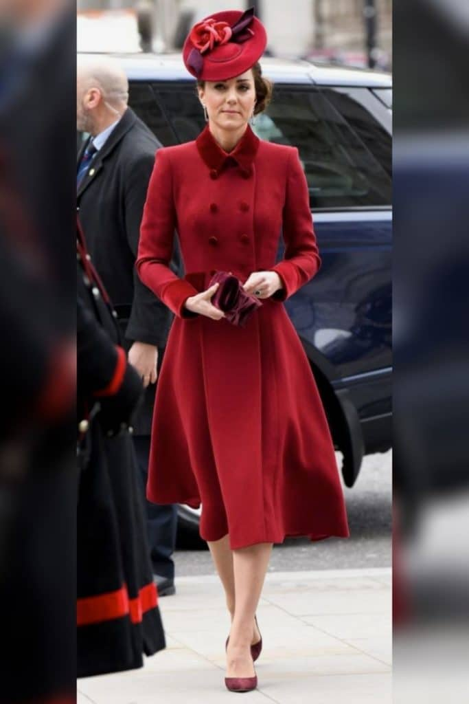 Kate Middleton wearing a red coat dress.
