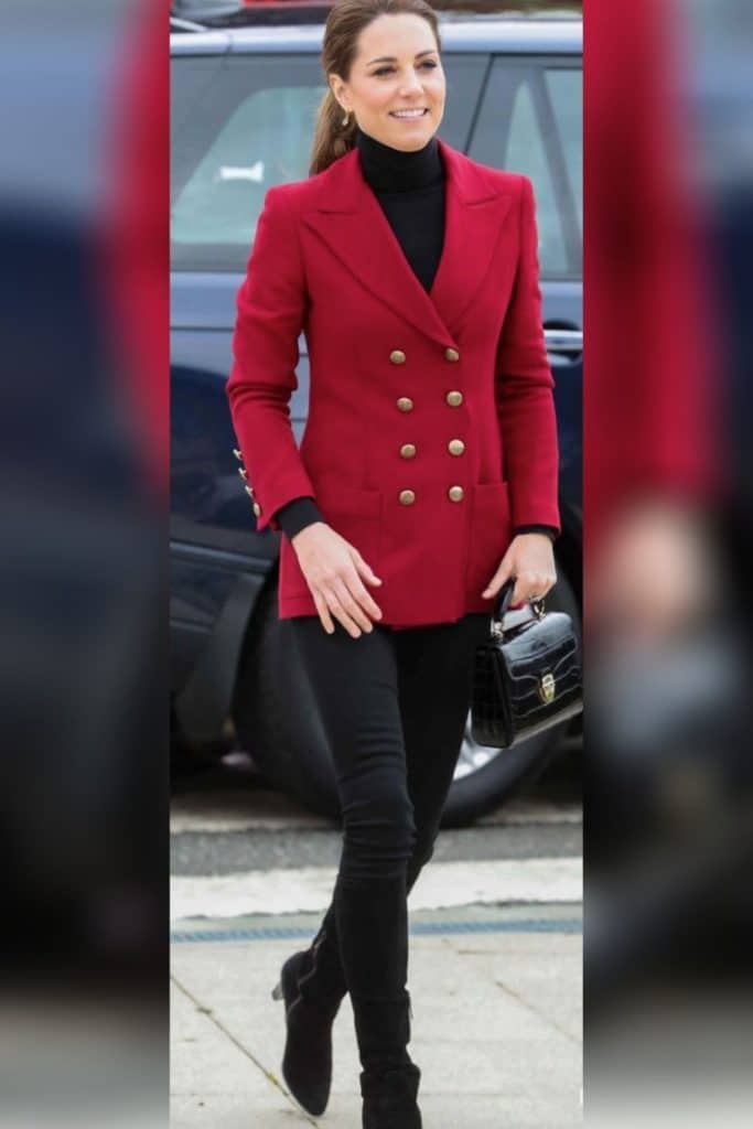 Kate Middleton wearing a red blazer with black skinny jeans.