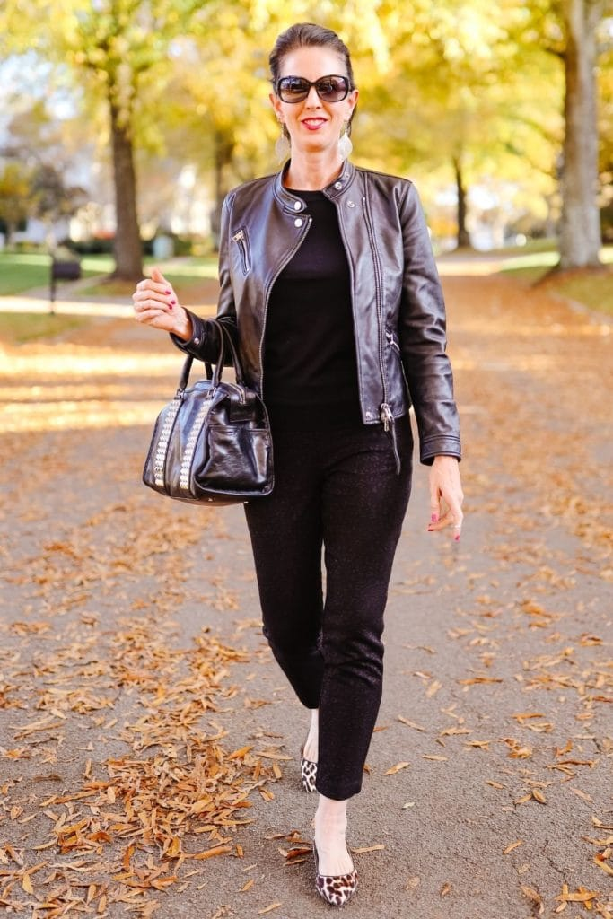 April from Stunning Style showing off her signature edgy classic style by wearing all black leather jacket, leather bag and leopard print flats.