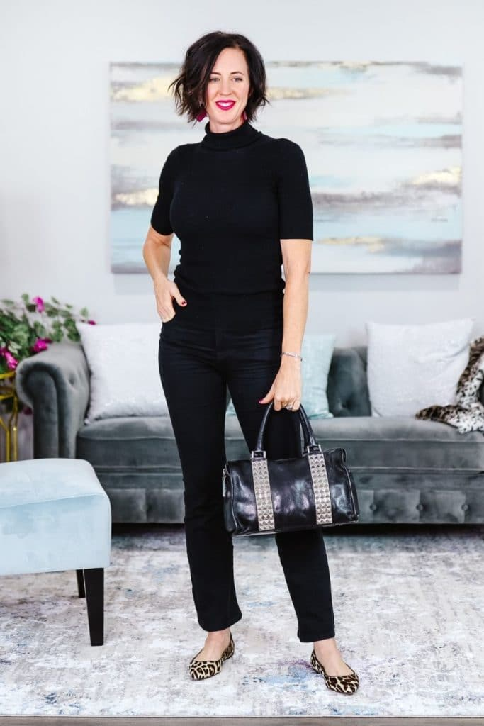 April from Stunning Style showing off her signature edgy classic style by wearing black pants and top with a leather bag and leopard print flats.