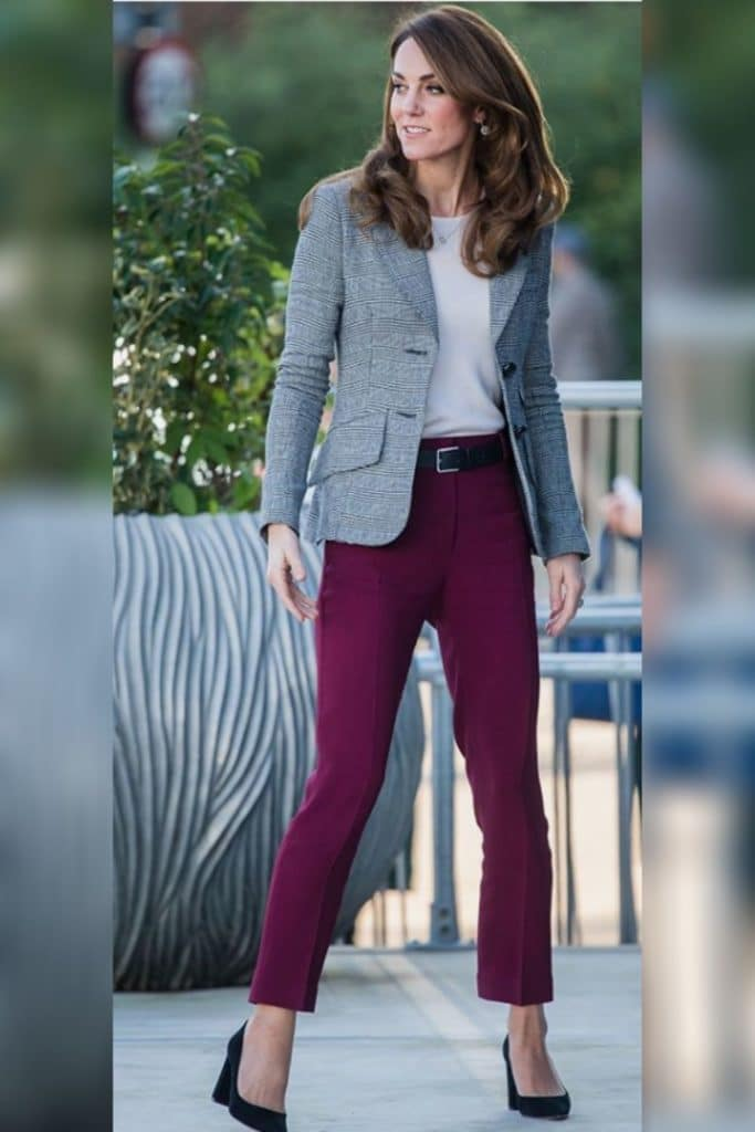Kate Middleton wearing dark pink skinny jeans with a grey blazer.