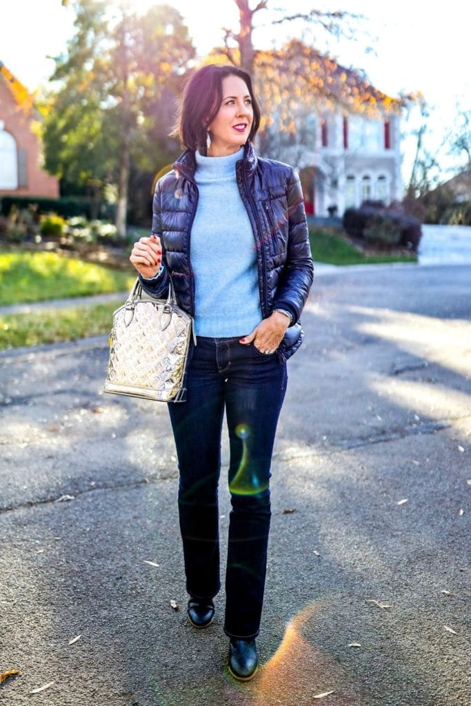 April from Stunning Style showing her signature style by wearing a blue turtleneck sweater, black jacket, jeans and boots.
