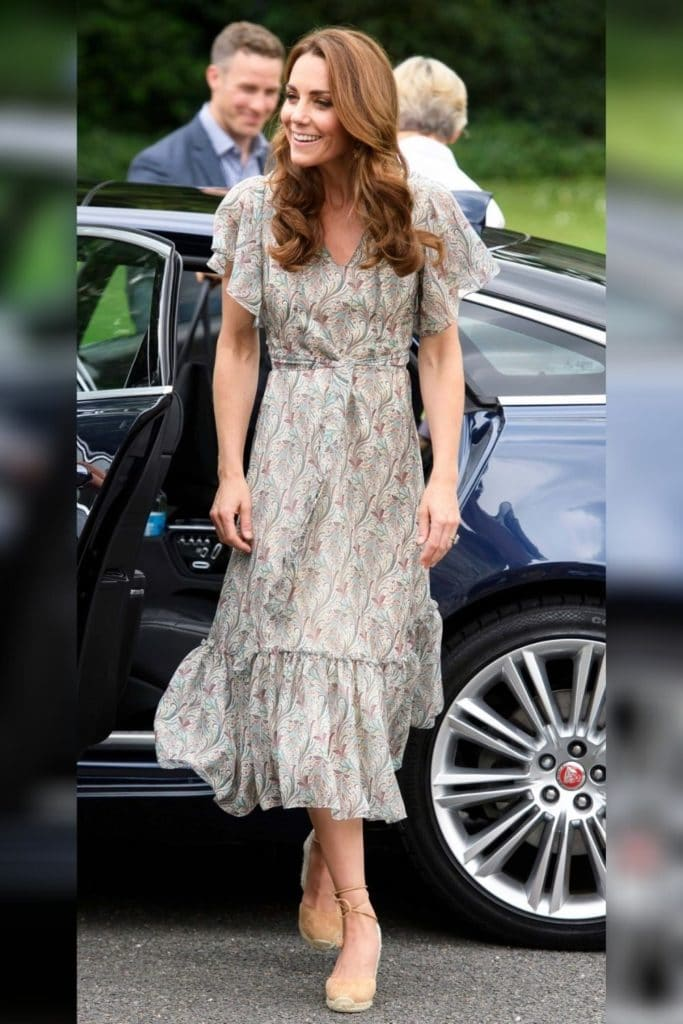 Kate Middleton wearing a neutral patterned fit and flare dress with flutter sleeves.
