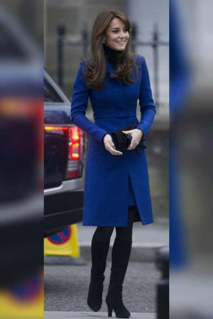Kate Middleton wearing a long blue coat.
