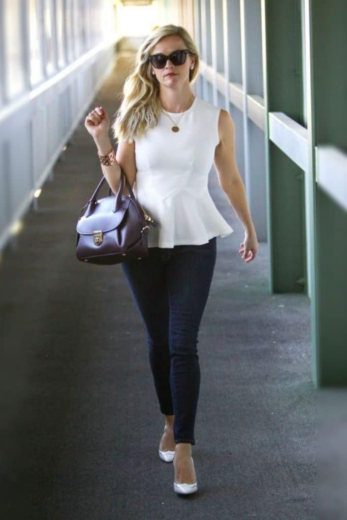 Reese Witherspoon showing off her signature silhouette by wearing a peplum top.