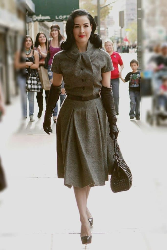 Dita Von Teese wearing a gray dress.
