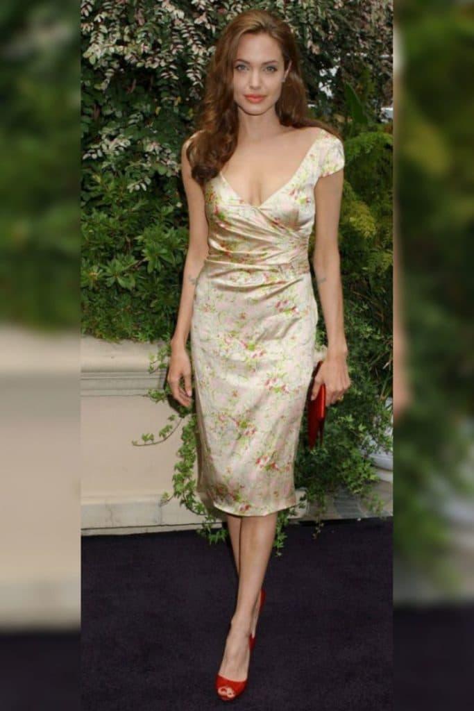 Angelina Jolie wearing a gold dress.