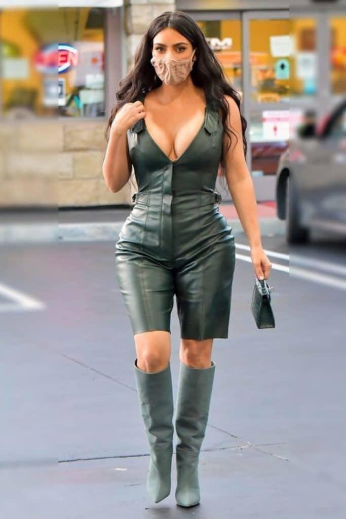Kim Kardashian wearing a green leather body suit.