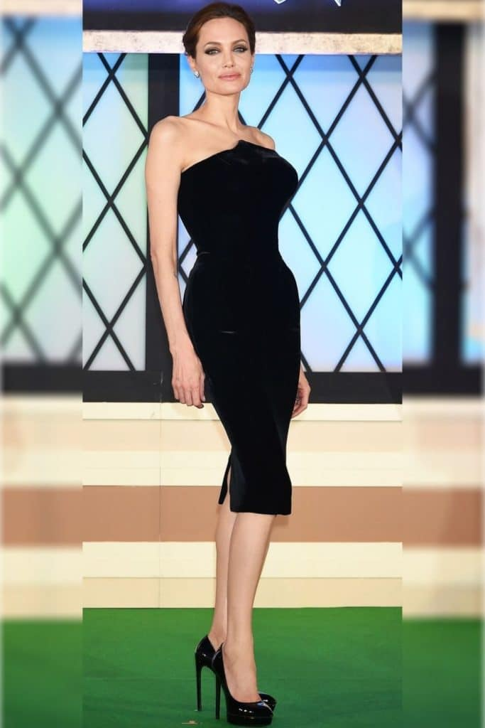 Angelina Jolie wearing a black dress.