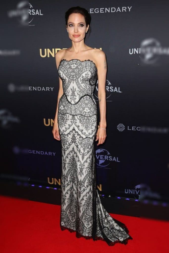 Angelina Jolie wearing a silver dress.