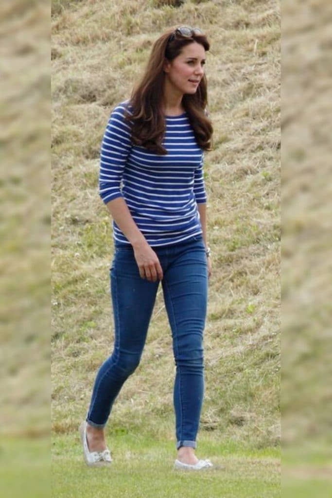 Kate Middleton wearing a blue striped top and jeans.