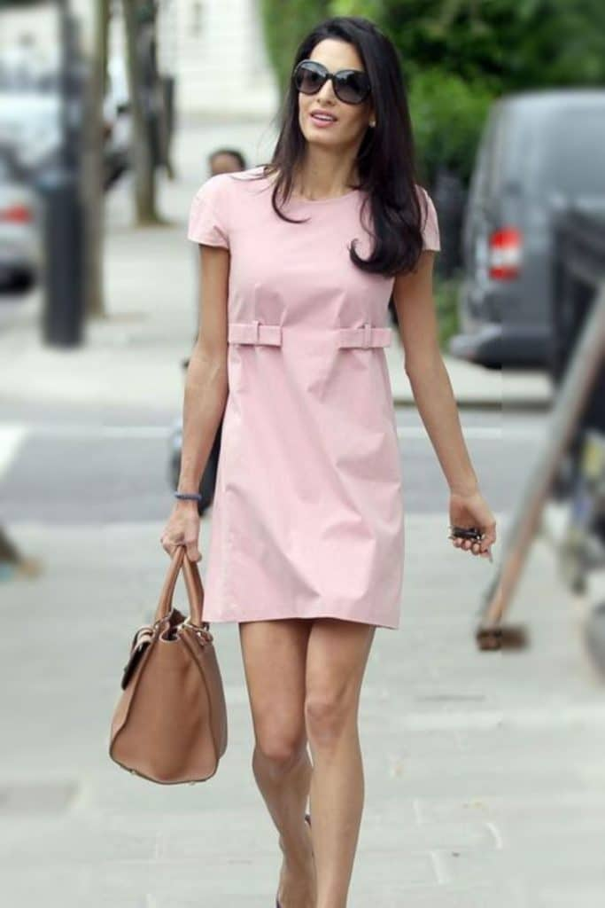 Amal Clooney wearing a pink dress.