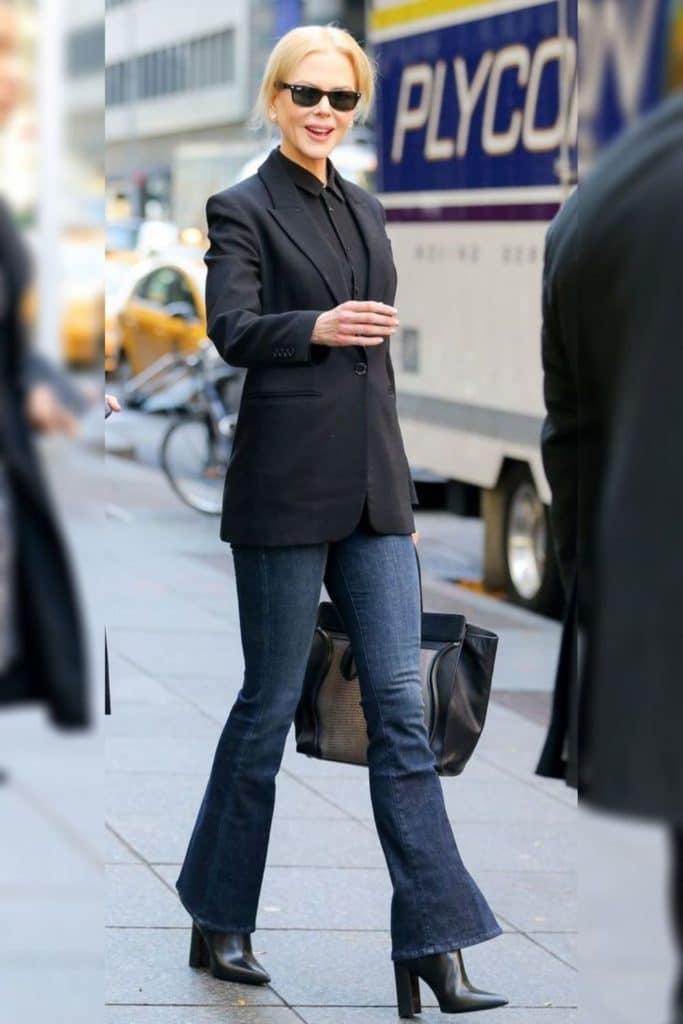 Nicole Kidman wearing a black jacket and jeans.
