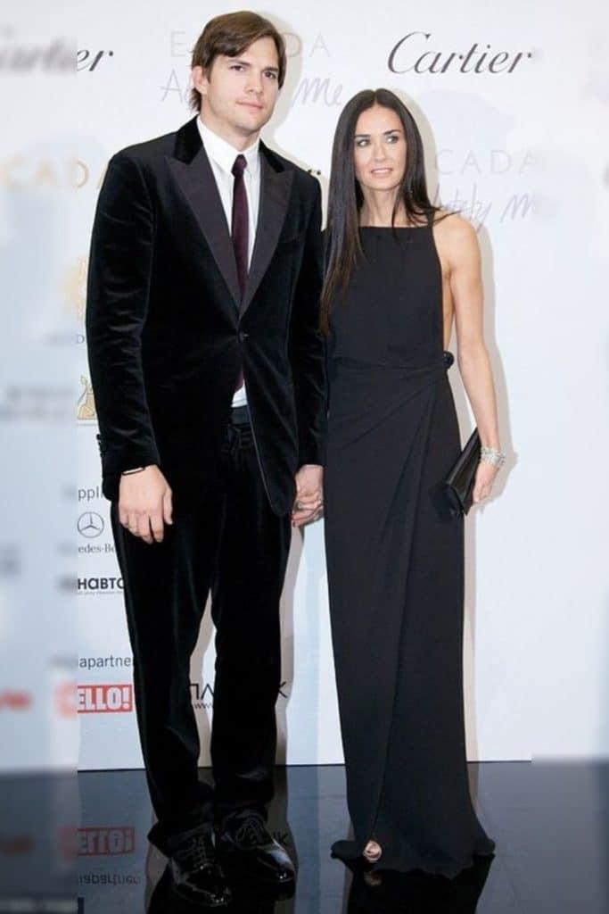 Demi Moore wearing a black dress.