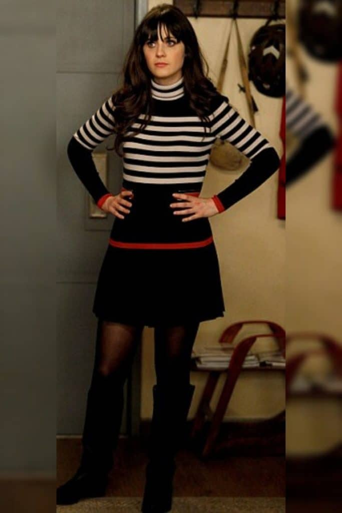 Zooey Deschanel wearing a fit and flare skirt with striped knit top as part of her signature silhouette.