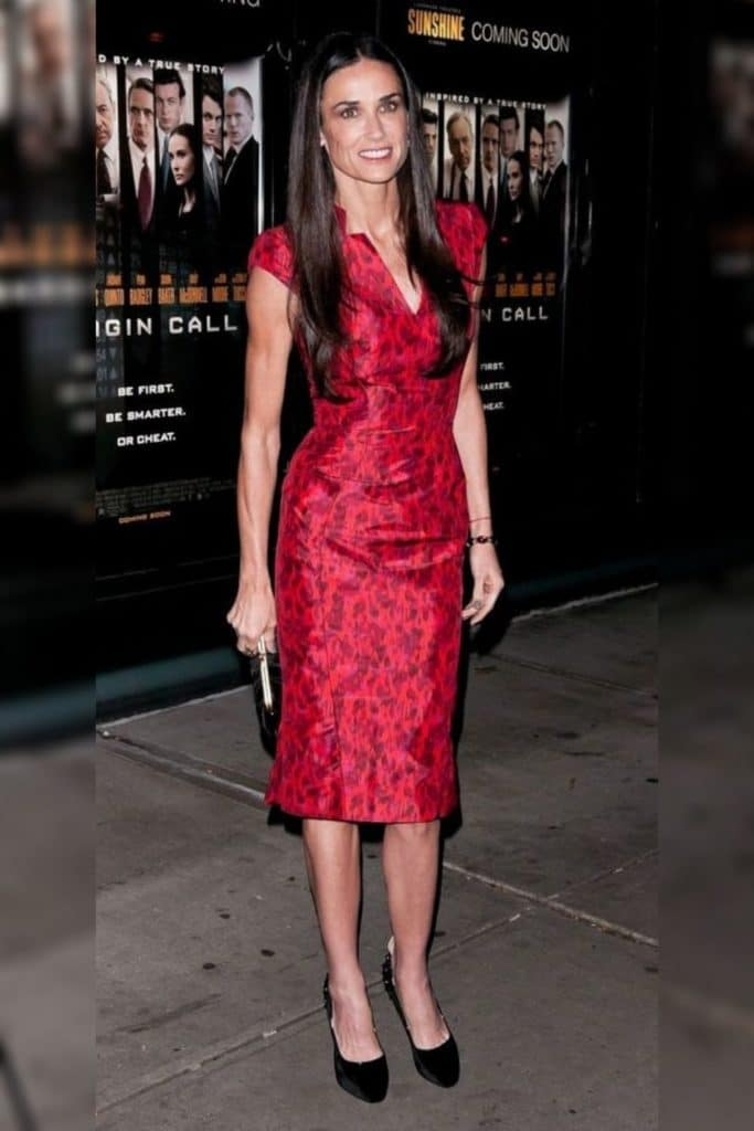 Demi Moore wearing a red dress.