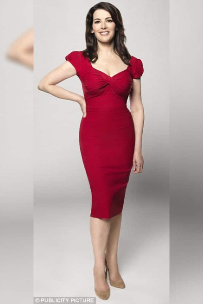 Nigella Lawson photoshopped for a media image and wearing a red dress showing off her hourglass body type.