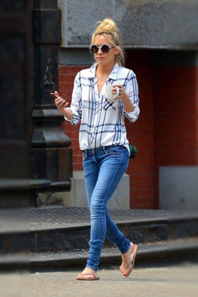 Kate Hudson wearing a plaid top with jeans.