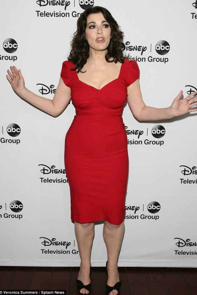 Nigella Lawson wearing a red dress showing off her hourglass body type.