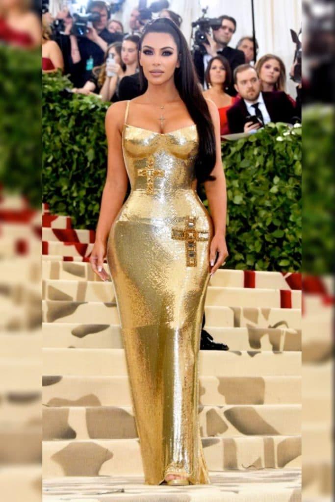 Kim Kardashian wearing a gold dress.