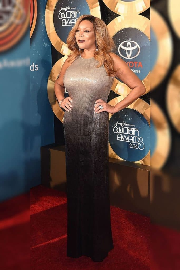 Wendy Williams wearing a silver and black dress.