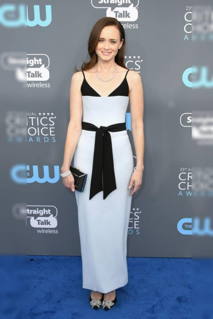 Alexis Bledel wearing a white and black dress.
