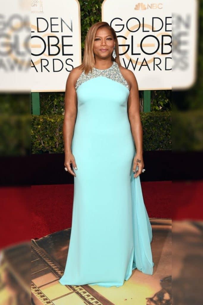Queen Latifah wearing a blue dress.