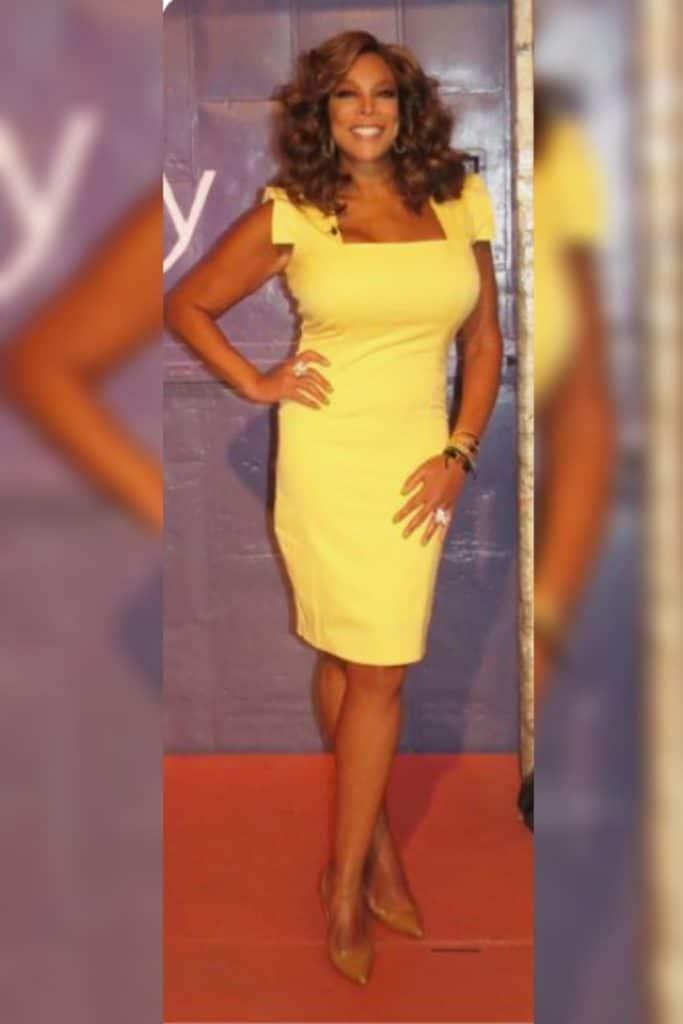 Wendy Williams wearing a yellow dress.