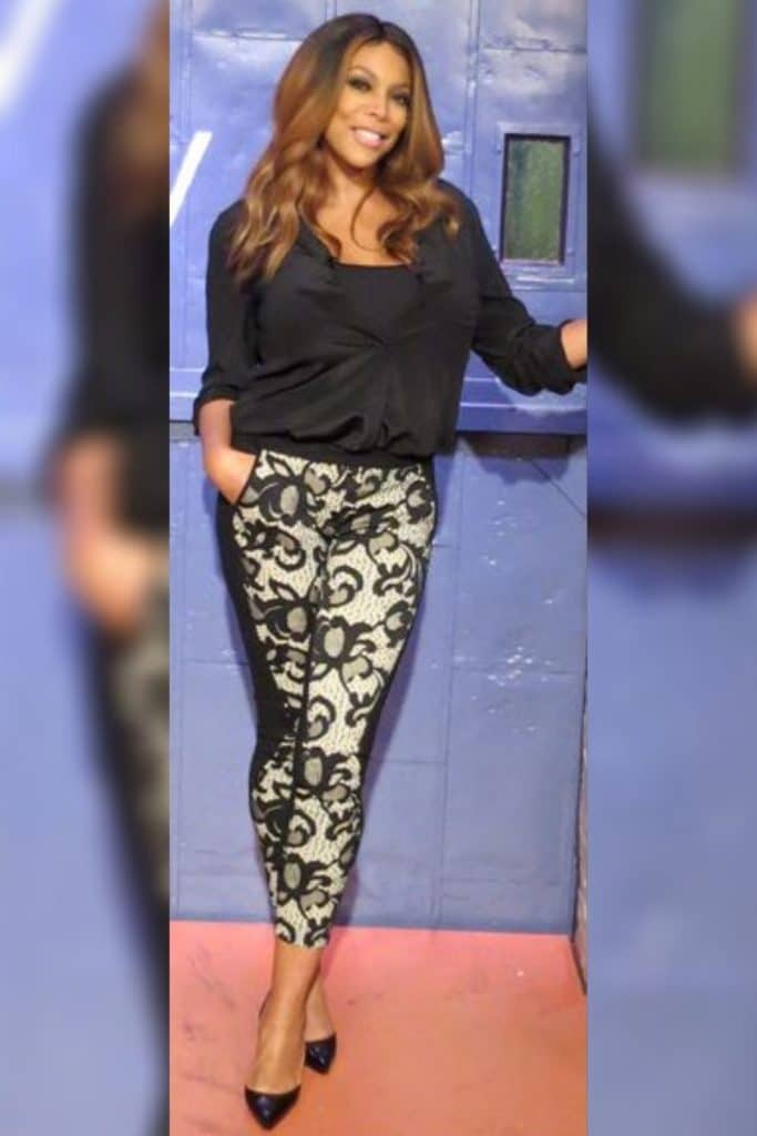 Wendy Williams wearing a black top with patterned pants