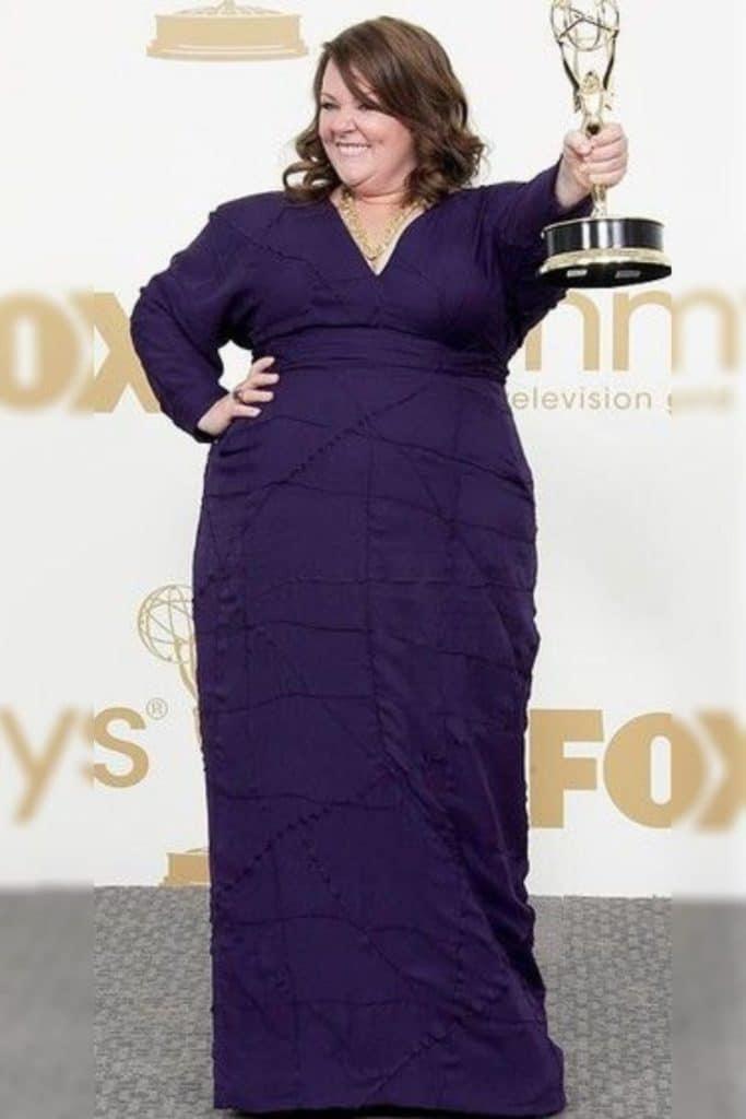 Melissa McCarthy wearing a purple dress.