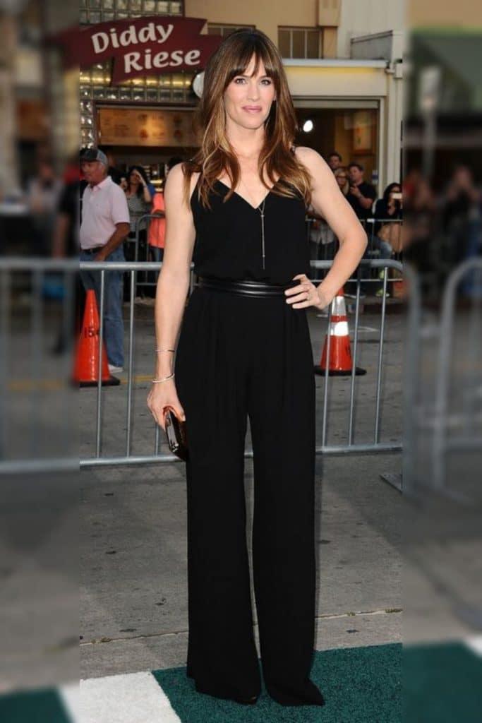 Jennifer Garner wearing a black top with black pants.