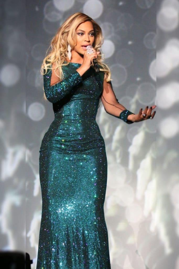 Beyonce wearing a green dress.