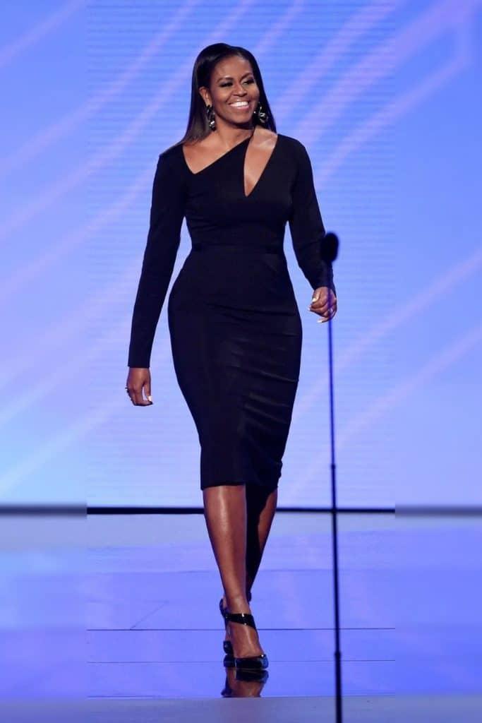 Michelle Obama wearing a black dress.