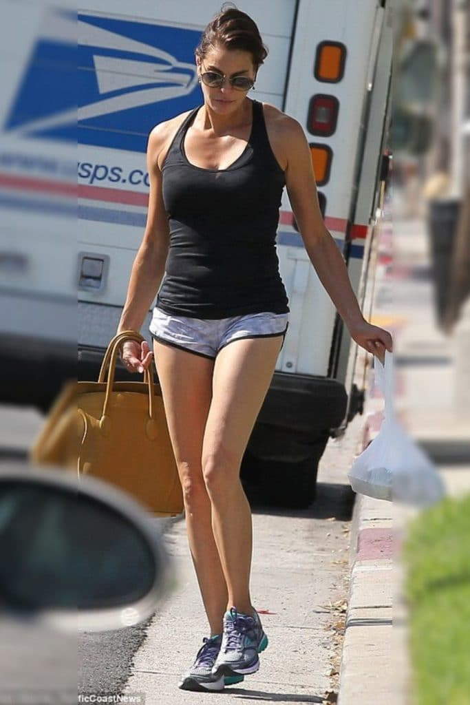 Terri Hatcher wearing a black tank top and shorts.